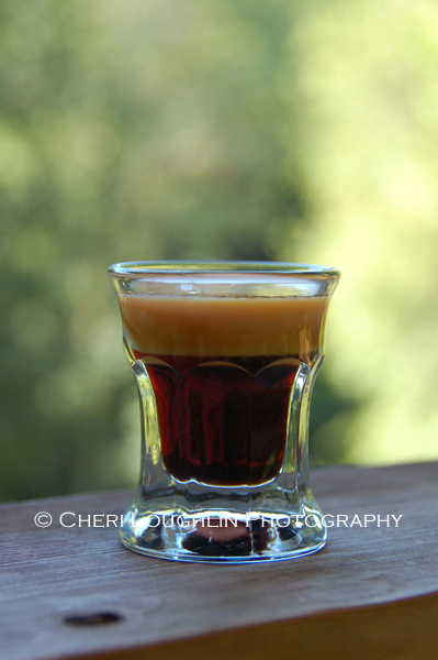 Baby Guinness layered shot is meant to mimic the look of a real Guinness beer when layered correctly. It is an easy two ingredient drink recipe.
