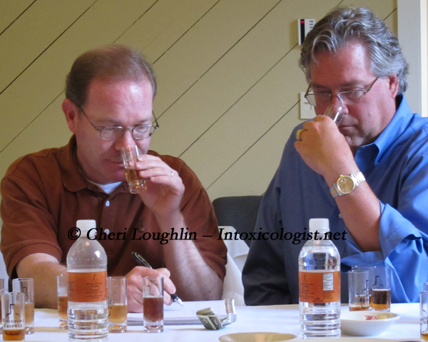 Chris Morris and Tim Laird Nosing the Cocktail Choices photo copyright Cheri Loughlin