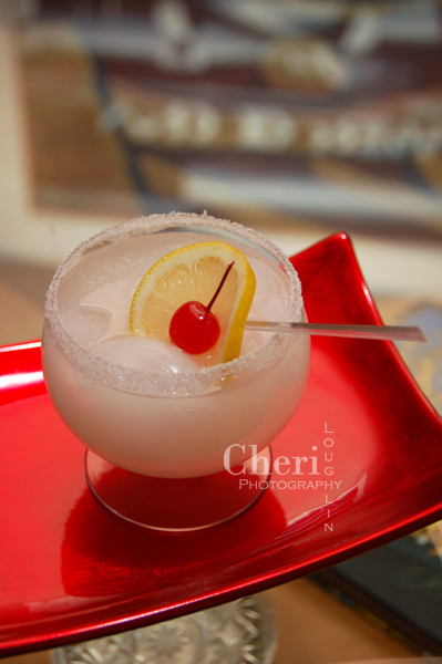 Cherry Blossom - Cruzan Black Cherry Rum, Orgeat Almond Syrup, White Cranberry Juice, Lime Powder and Sugar Rim