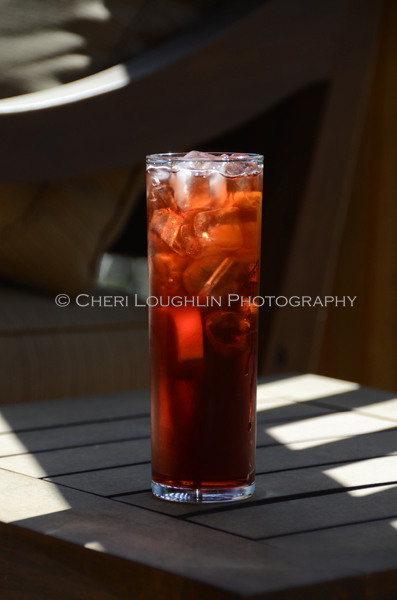The Americano classic cocktail is a lovely summer sipper that easily plays out well as a holiday drink with its vibrant red color and deep, lush flavor. - photo by Cheri Loughlin, The Intoxicologist