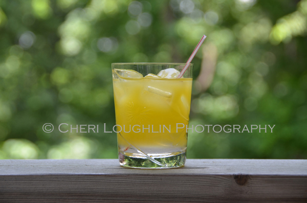 Peach Bikini Cocktail variation on the higher calorie Fuzzy Navel summer favorite - recipe and photo by Mixologist Cheri Loughlin, The Intoxicologist