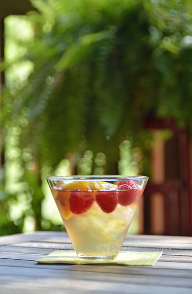 Sweet Raspberry Peach Sangria is quick and easy to put together in just a few minutes using fresh summery peaches, delicious raspberries, moscato white wine, brandy, raspberry liqueur and simple syrup. - recipe and photo by Mixologist Cheri Loughlin, The Intoxicologist