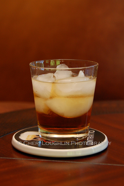 The Rusty Nail and Godfather Scotch Cocktails are two ingredient drinks. One uses Drambuie, the other uses Amaretto. Measurements vary depending upon bartender, website or cocktail book. Godfather drink pictured. - photo by Mixologist Cheri Loughlin, The Intoxicologist