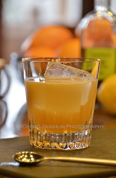Sam Ross created the Penicillin drink in 2005. He uses a house made Honey-Ginger Syrup. I used a Ginger-Vanilla Syrup. - photo by Mixologist Cheri Loughlin, The Intoxicologist