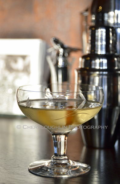 The Wizard Cocktail from Vodka Distilled turns out with rich layered flavor. There is a bit of citrus spice in the aroma. A mix of orange and herbal notes linger on the tongue. - photo by Mixologist Cheri Loughlin, The Intoxicologist