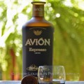 Avion Espresso Liqueur - Avion Tequila 020 Avion Espresso Liqueur taster shot with wooden bottle cap along side. - photo by Mixologist Cheri Loughlin, The Intoxicologist