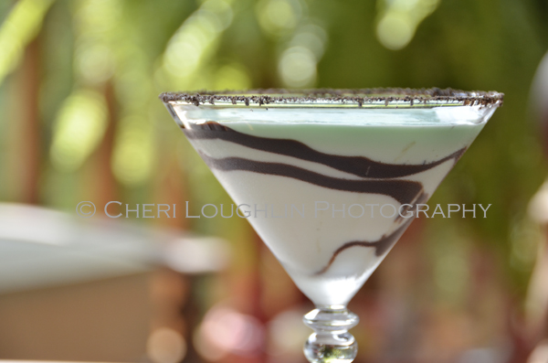 Chocolate Mint Cookie Cocktail 082 with Creme de Menthe Liqueur, Cake Vodka, Chocolate Vodka, Creme de Cacao, Half & Half with crushed Oreo cookie rim, chocolate swirl and mint leaf garnish. - recipe and photo by Mixologist Cheri Loughlin, The Intoxicologist
