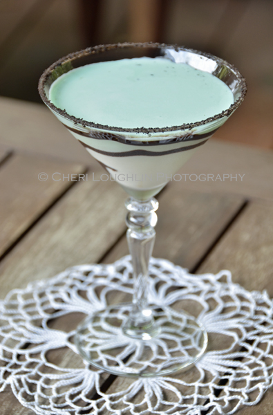 Chocolate Mint Cookie Cocktail 106 with Creme de Menthe Liqueur, Cake Vodka, Chocolate Vodka, Creme de Cacao, Half & Half with crushed Oreo cookie rim, chocolate swirl and mint leaf garnish. - recipe and photo by Mixologist Cheri Loughlin, The Intoxicologist