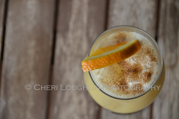 Pusser's Rum Painkiller Cocktail - Give the Painkiller a hearty shake for foamy head, generous sprinkle of nutmeg for nutty spice flavoring and orange slice garnish for splash of color. - photo by Mixologist Cheri Loughlin, The Intoxicologist