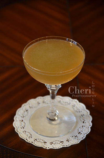 Apricot Bonfire Fall Cocktail is little more than a warming apricot daiquiri using dark rum and apricot brandy. {photo credit: Mixologist Cheri Loughlin, The Intoxicologist www.intoxicologist.net}