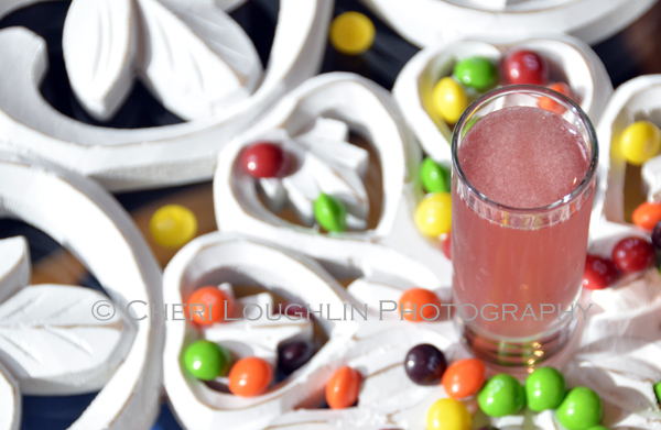 Skittle Shot 076 is a fun candy themed shot ideal for Halloween parties, celebrating PINK for Breast Cancer Awareness month and of course raising a toast to National Vodka Day. - photo credit to Mixologist Cheri Loughlin, The Intoxicologist