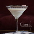Candy Cane Martini created for Shellback Rum using peppermint schnapps, dark sumatra syrup and half & half with candy cane garnish {recipe and photo credit: Mixologist Cheri Loughlin, The Intoxicologist www.intoxicologist.net}