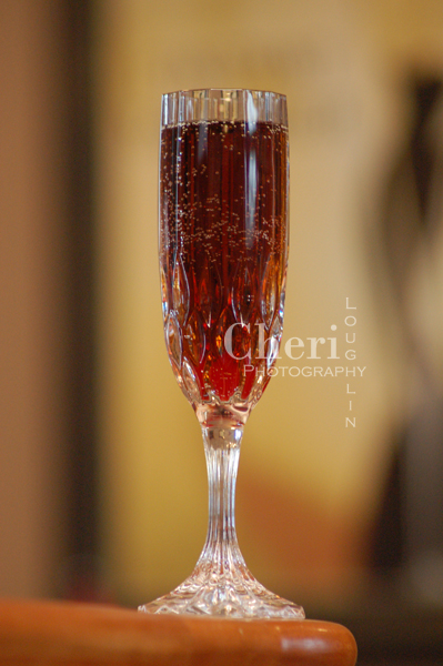 The Black Pearl champagne cocktail is lush tasting with dark, rich color. It is easy to make with three liquid ingredients and simple maraschino cherry garnish.