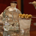 Bare Bones – recipe by Cheri Loughlin, The Intoxicologist 2 ounces Crystal Head Vodka Ice Garlic Stuffed Green Olives