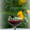 Fresh blackberries and cabernet sauvignon wine give the Royal Cornucopia cocktail its regal color. Coconut juice and brown sugar add light warming sweetness