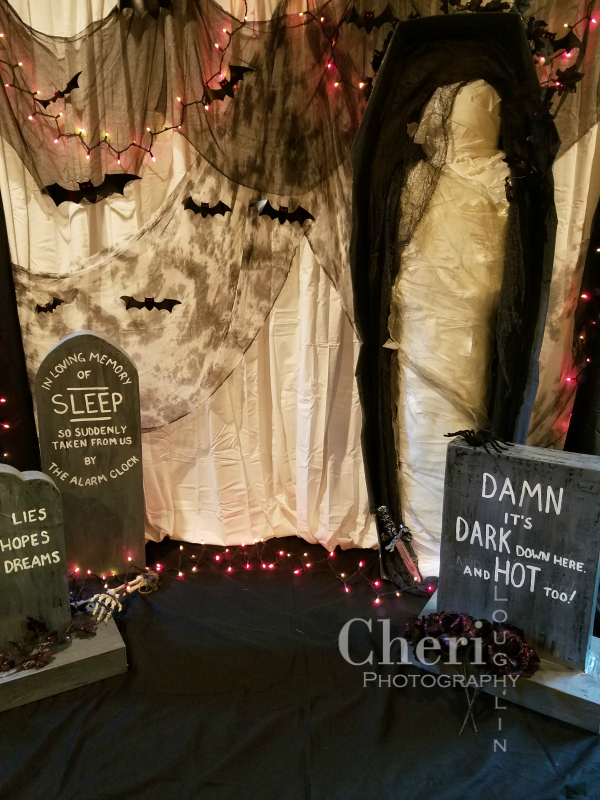 Create a fun backdrop for selfies. Paper Mache tombstones, Mummy made from cardboard, egg cartons, newspaper, tape and fabric strips with sheets for backdrop.
