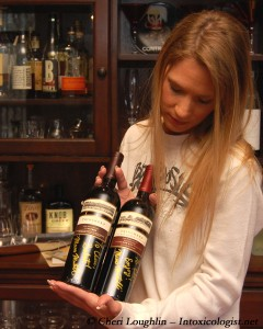 The Intoxicologist with Chicken Ranch Vineyard Cabernet Sauvignon 2006 and Napa Valley Meritage 2006 - photo property of Cheri Loughlin - The Intoxicologist