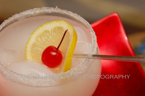 Cherry Blossom Frozen Cocktail with Cherry and Lemon Wheel Cocktail Garnish