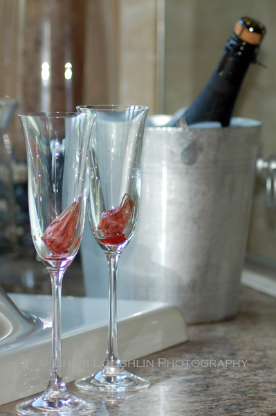 Hibiscus flowers in champagne flutes. Spanish Cava in champagne bucket. - photo by Cheri Loughlin, The Intoxicologist