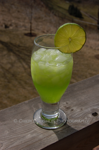 Lunar Leprechaun uses Melon Liqueur for a new color and new flavor take on the traditional Margarita. – photo and recipe by Mixologist Cheri Loughlin, The Intoxicologist