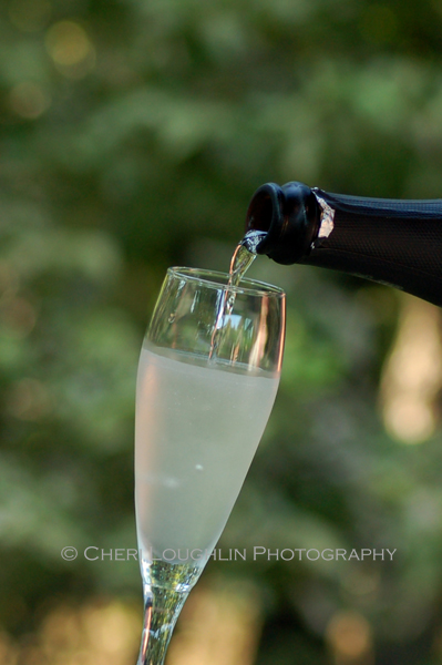 Hold champagne flute at an angle when pouring champagne into glass. - photo by Cheri Loughlin, The Intoxicologist