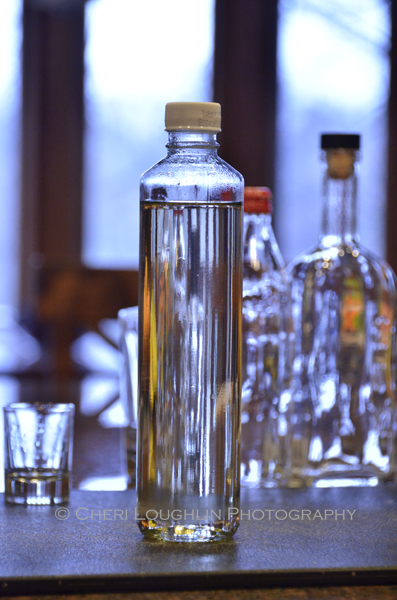 Clean and reuse emptied liquor bottles for your simple syrup recipe, sour mixes and other infusions. - photo by Cheri Loughlin, The Intoxicologist