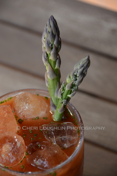 Twisted Sister Bloody Mary made with Campari, Bourbon and Gin. Garnished with asparagus spears. Includes seasonings of wasabi and ginger. An ideal masterpiece for the Bloody Mary Bar. - photo and recipe by Mixologist Cheri Loughlin, The Intoxicologist