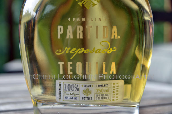 Partida Tequila Reposado 012 close up of bottle label. - photo by Mixologist Cheri Loughlin, The Intoxicologist