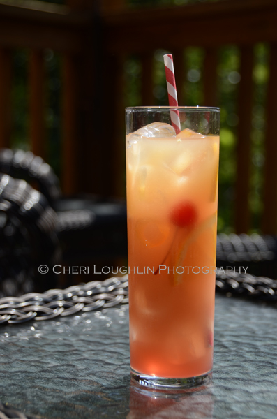 Tiki Screwdriver 093 is a Tiki drink variation on the classic Screwdriver long drink. Tiki Screwdriver uses Shellback Silver Rum, Passionfruit Juice, Ruby Red Grapefruit Juice and Grenadine in addition to the usual Screwdriver ingredients. The recipe could be multiplied for pitcher or punch bowl use. Ideal for National Rum Punch Day. - photo and recipe by Mixologist Cheri Loughlin, The Intoxicologist