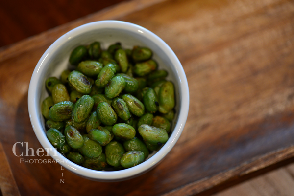 Spicy Roasted Edamame - Great bar snack to pair with beer or sake cocktails. {recipe and photo credit Cheri Loughlin}