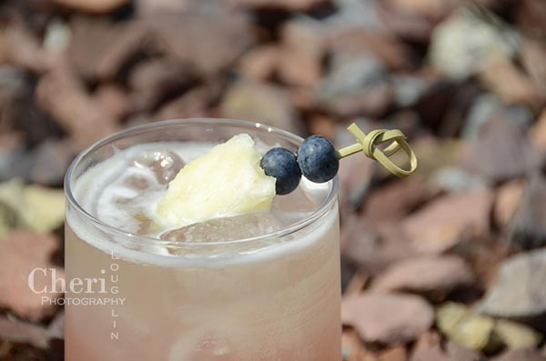Pineapple Blueberry and Basil Cocktail - Shellback Silver Rum, Lemon Juice, Simple Syrup, Pineapple, Blueberries, Basil, Club Soda