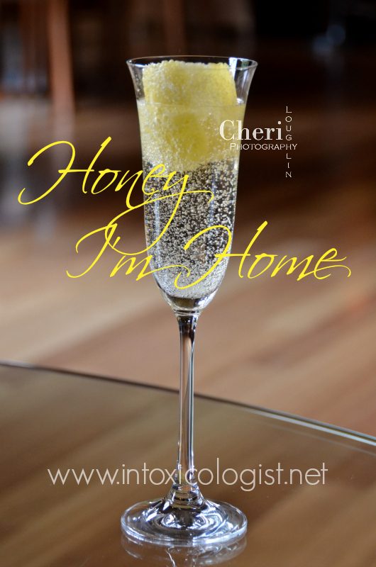 The Honey I'm Home bubbly drink uses honey flavored whiskey. The flavor is lightly sweet with a hint of honey whiskey warmth. Brut Cuvee adds crispness to the cocktail. What's not to love about bubbles tickling at your nose?!