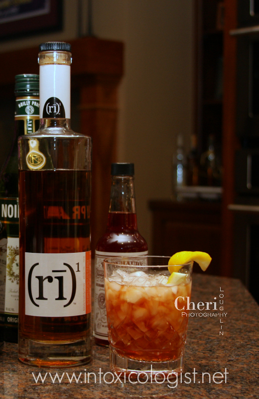 """(ri)1, pronounced """"rye one"""", is not only impressive in stature with its sleek bottling, but better yet it is remarkable in taste. This rye carries with it the feel of modern, cutting edge sophistication while maintaining the classic rye whiskey tradition."""