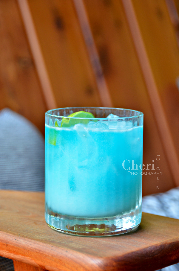 The Mermaid Margarita is a tropical, take me to the beach margarita style cocktail. Blue Curacao provides the deep blue sea color, while coconut and lime juice capture the essence of white caps on waves.